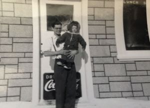 My father and I in front of restaurant, barbershop and poollhall circa 1953   Photo: unknown